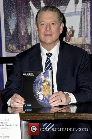 Al Gore signs copies of his book 'Our Choice: A Plan to Solve the Climate Crisis' for Book Soup at...