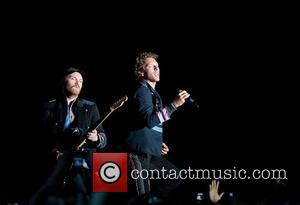 Jonny Buckland and Chris Martin of Coldplay All Points West festival held at Liberty State Park Jersey City, New Jersey...