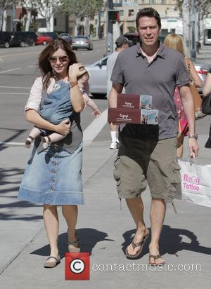 Alyson Hannigan, Alexis Denisof and Daughter Satyana Denisof
