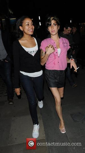 Amy Winehouse with her Goddaughter Dionne Bromfield  after dining at the Fish Works Restaurant, Marylebone. Sporting a stain on...