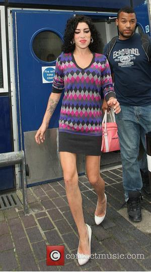 Amy Winehouse arriving at Gatwick airport after flying in from St Lucia London, England- 13.07.09