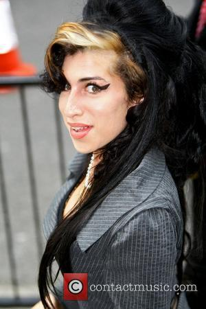 Amy Winehouse  arriving at City of Westminster Magistrates Court to face charges of assault London, England - 23.07.09