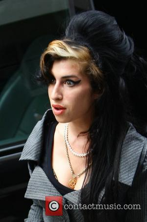 Mitch Winehouse's Mixed Feelings Following Amy's Oscar And Brit Nominations