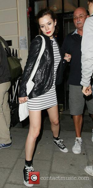 Anna Friel leaving a hotel wearing converse trainers and a black and white stripped dress and a sequined blazer London,...