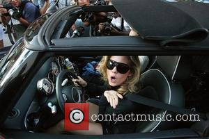 AnnaLynne McCord and her sister are mobbed by photographers as they drive through Beverly Hills in her Mini Cooper