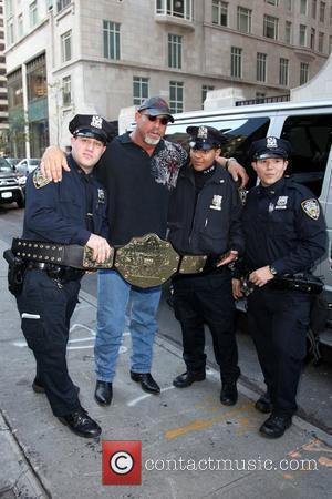 Bill Goldberg poses with NYPD police officers outside his hotel New York City, USA - 20.10.09