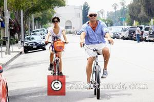 Billy Zane  and his girlfriend ride bicycles in Beverly Hills Los Angeles, California - 28.08.09