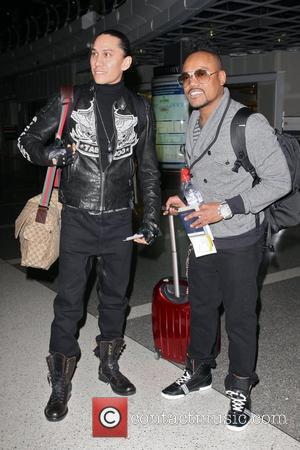 Taboo and Apl.de.ap of the Black Eyed Peas arriving at the Tom Bradley international terminal at LAX to catch an...