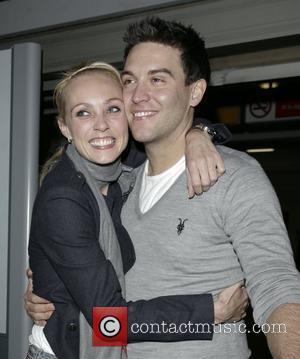 Camilla Dallerup and her fiance Kevin Sacre arriving at at Heathrow Airport London, England - 21.11.09