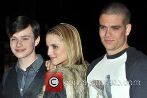 Chris Colfer, Dianna Agron and Mark Salling The cast of Glee sign copies of 'Glee: The Music Vol. 1 at...