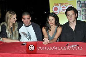 Dianna Agron, Mark Salling, Lea Michele and Cory Monteith The cast of Glee sign copies of 'Glee: The Music Vol....