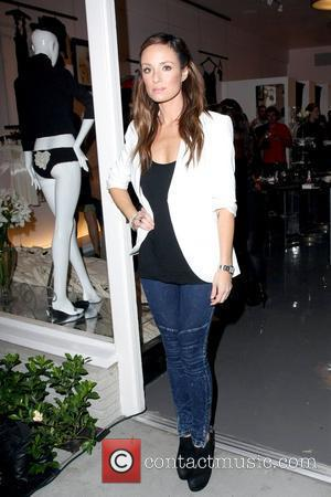 Catt Sadler outside the Undrest Pop Shop opening in West Hollywood Los Angeles, California - 12.11.09