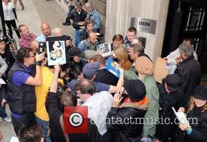 Olivia Newton-John  signs autographs outside the BBC Radio 2 studios with her husband John Easterling  London, England -...