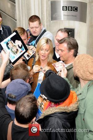 Olivia Newton-John  signs autographs outside the BBC Radio 2 studios with her husband John Easterling  London, England -...
