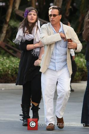 Andy Garcia and his daughter,  arrive for the first game of the NBA National Championship Tournament between the L.A....