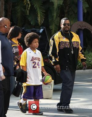 Ice Cube and Family arriving at the first game of the NBA National Championship Tournament between the L.A. Lakers and...