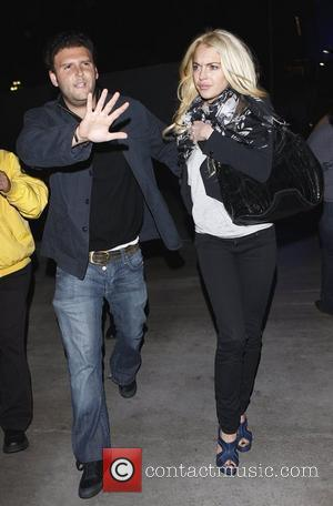Lohan's Bodyguard Arrested