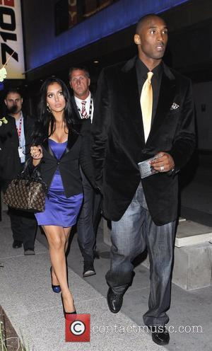 Kobe Bryant and his wife Vanessa Laine leave the Staples Center with a friend after watching the LA Lakers play...