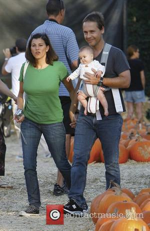 Chad Lowe, Kim Painter and baby daughter Mabel Painter Lowe visit Mr. Bones Pumpkin Patch to select a pumpkin for...