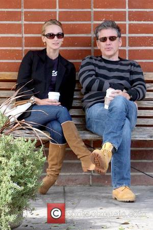 Megan Wallace-Cunningham and Craig Ferguson host of 'The Late Late Show with Craig Ferguson' sitting on a bench with his...