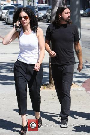 Foo Fighters frontman Dave Grohl out and about walking on Sunset Boulevard with friends Los Angeles, California - 25.09.09