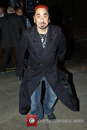 David Gest  leaves Hope Street Hotel sporting bright red hair and a trench coat decorated with a sparkling image...