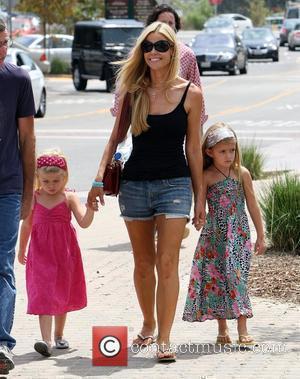 Denise Richards shops with her father Irv Richards and her daughters Lola Rose Sheen-Estevez and Sam J. Sheen-Estevez Los Angeles,...