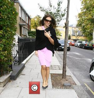 Elizabeth Hurley leaves her home to attend a Estee Lauder photocall London, England - 22.10.09