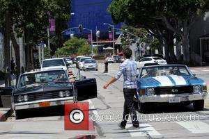 Adrian Grenier and Kevin Dillon Cast members of 'Entourage' filming a scene at Urth Cafe in West Hollywood Los Angeles,...