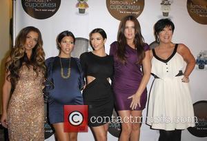 Guest, Kim Kardashian and Kourtney Kardashian