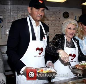 John Demsey and Joan Rivers