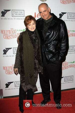Carolyn Hennesy and Guest The 2009 Hollywood Christmas Parade/Live Positively Presented by Coca-Cola held on Hollywood Boulevard Hollywood, California -...