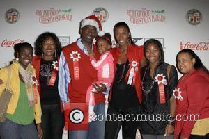 Lisa Leslie and Family The 2009 Hollywood Christmas Parade/Live Positively Presented by Coca-Cola held on Hollywood Boulevard Hollywood, California -...