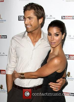 Eric Winter and Roselyn Sanchez The Hollywood Reporter's Philanthropist Of The Year Award Reception held at BOA Sunset in West...