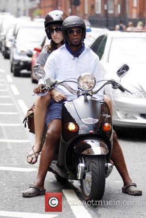 Ian Wright on his scooter with his girlfriend London, England - 03.07.09