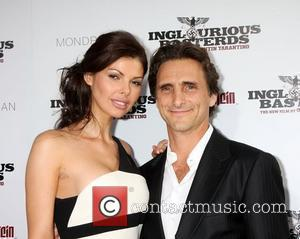Lawrence Bender and Guest  Los Angeles Premiere of Inglourious Basterds Premiere held at The Grauman Chinese Theatre - arrivals...