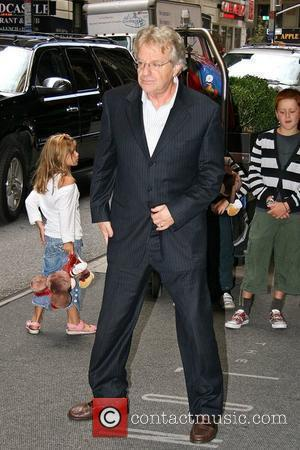 Jerry Springer poses for photographs as he arrives at his Manhattan hotel New York City, USA - 27.08.09