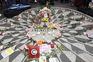 Fans pay tribute to the late John Lennon on what would have been the Beatle's 69th birthday. The gathering took...