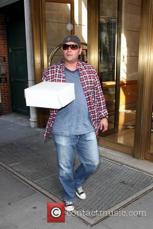Jon Gosselin  leaves his New York City apartment with a birthday cake and heads to a birthday party for...