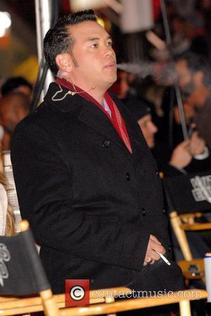 Jon Gosselin smoking while on the set of 'The Insider' filming in Times Square New York City, USA - 09.11.09