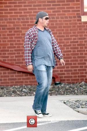 Jon Gosselin  goes to pick up money at a bank before heading to the birthday party for his twin...