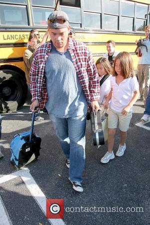 Jon Gosselin  meets his twin daughters, Cara and Mady, at their school bus stop before their birthday party Waterville,...