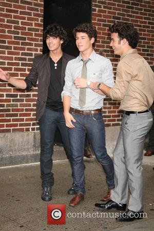 Kevin Jonas and David Letterman