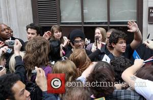 Kevin Jonas, Joe Jonas, Nick Jonas of the Jonas Brothers perform an impromptu concert  outside BBC Radio One studios...