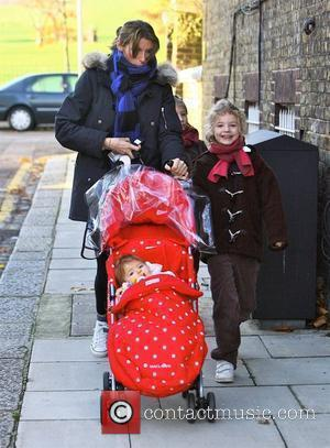 Jools Oliver leaving home with daughters Poppy Honey Oliver and Petal Blossom Rainbow Oliver London, England - 01.12.09