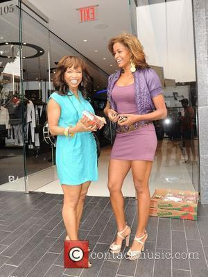 Elise Neal and Claudia Jordan buying Strawberries on Robertson Boulevard after having lunch at the Ivy Los Angeles, California -...