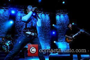 Singer Arnel Pineda and Guitarist Neal Schon  performs with the band Journey at Seminole HardRock Hotel and Casino...