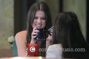 Khloe Kardashian and Her Sister Filming A Segment Of Their Reality Tv Show At Newsroom Cafe On Robertson Boulevard