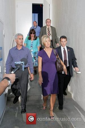 Kate Gosselin, wearing a purple Catherine Malandrino deep V dress, leaving CNN studios after appearing on 'Larry King Live'...