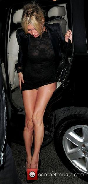 Kate Moss  reveals her underwear while getting out of a car as she arrives at her West End hotel....